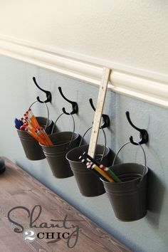 Art supply storage with buckets and hooks! Think it turned out cute. (totally think I could use these for
