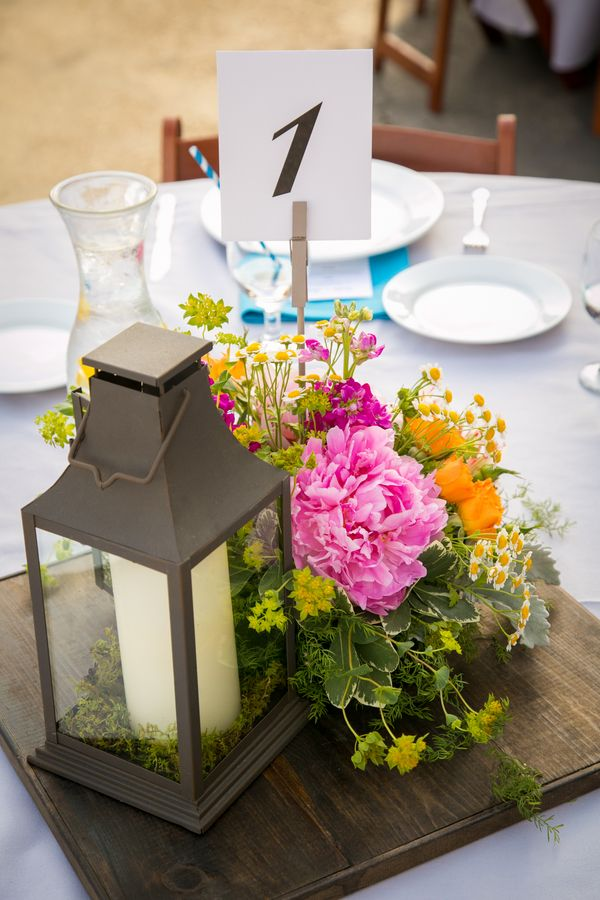 Lantern and floral centerpiece holds a graphic table number {Photo by A. Blake Photography via Project Wed