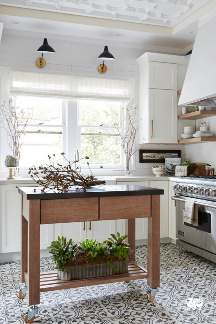 Make the most of a kitchen by adding a rolling kitchen cart, open shelving, and…