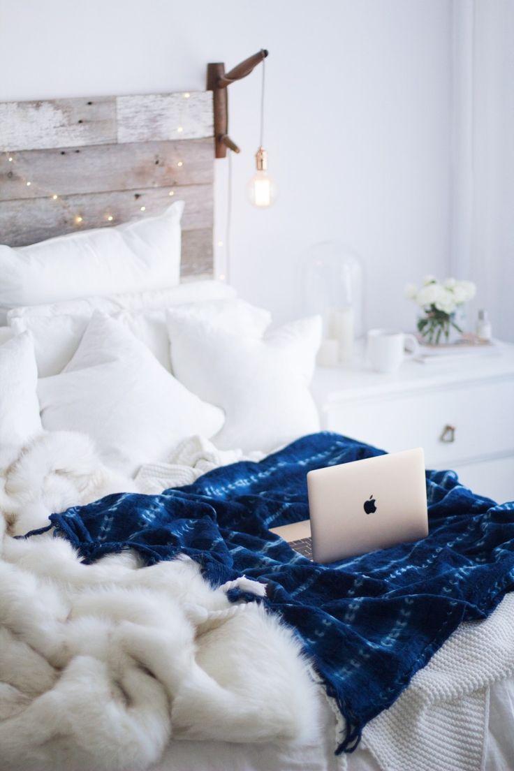 All white bedroom & boho indigo blanket
