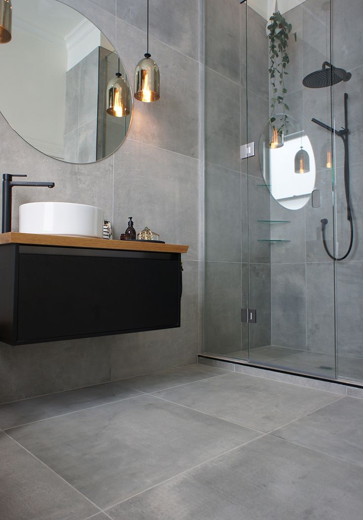 Cat s main bathroom, they used a large format tile called Cementia…