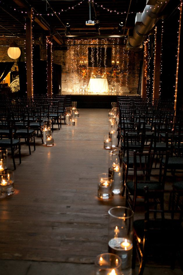 Impossibly romantic wedding ceremony set-up with twinkle lights and floating candl