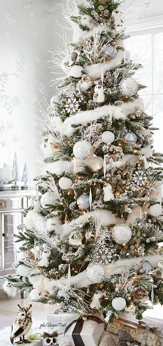 Holiday decorating – White on white Christmas tree with woodland creatures and whi