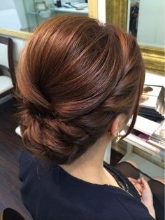 Elegant, polished, braided updo that would be perfect for any bridesmaid or bridal