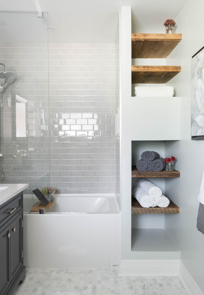Bathroom, white subway tile, mosaic floor tile, glass shower tub, wood shelving  