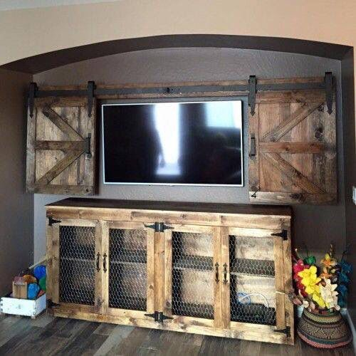I really want to do this! Awesome barn decor entertainment center area!