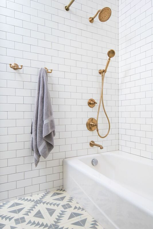 gold fixtures and patterned tile