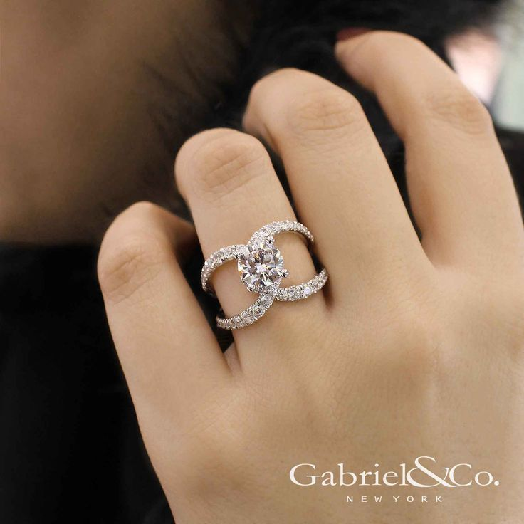 Gabriel & Co. – Voted #1 Most Preferred Bridal Brand.   A brightly, unique split shank band complements the classic round diamond