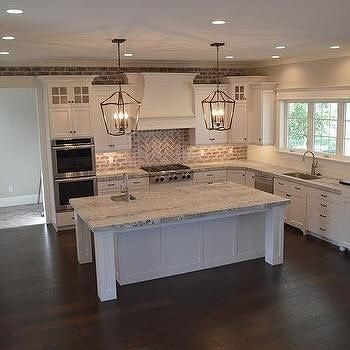 This kitchen not only used brick tiles for a backsplash but they extended them to the rest of the wall.  www.VintageBricks…