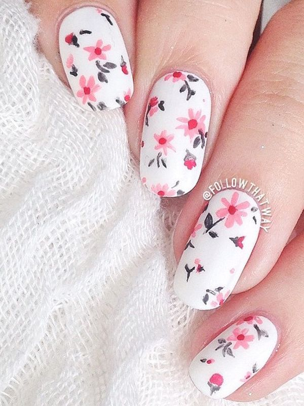 Give your nails a bright spring feel with this flower inspired nail art design. The falling pink flowers look perfect against the