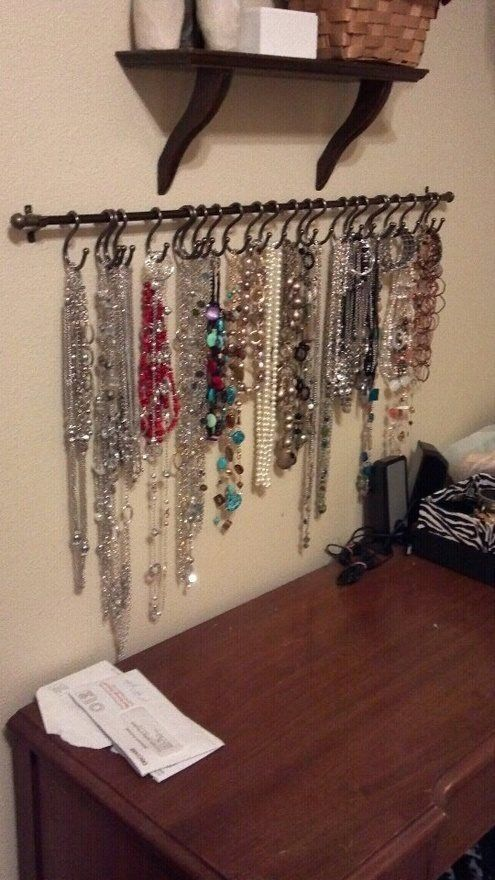 DIY necklace holder…small curtain rod and S-hooks, spray painted black and it would be perfect for hair ties/necklaces.
