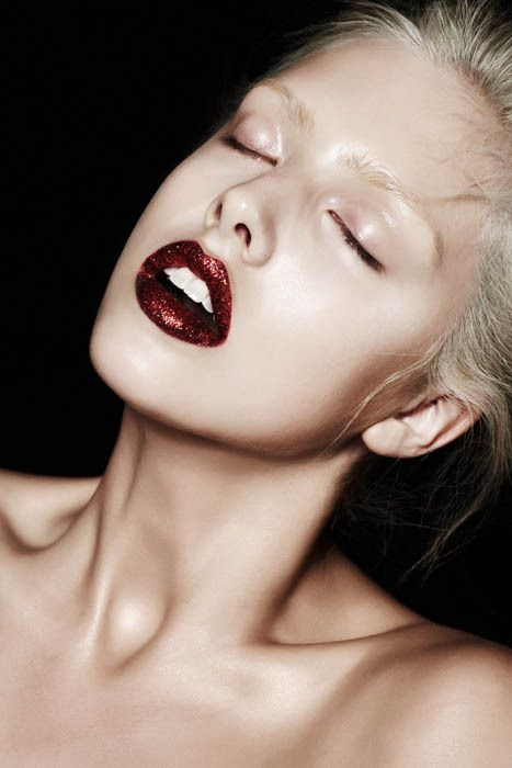 Shine like the rockstar you are in hot red glitter lips and make a dramatic entrance to your next holiday party.