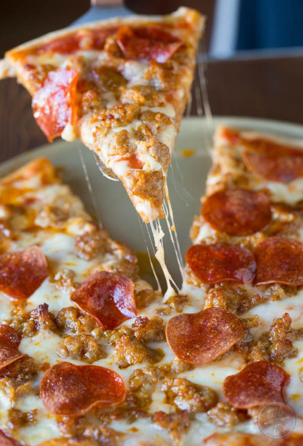 Spicy sausage and pepperoni pizza is so much better made at home than getting delivery! Youll thank me later.