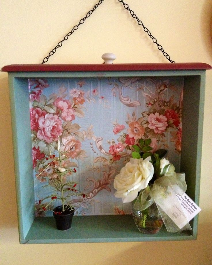 Recycled old drawer with wallpaper.