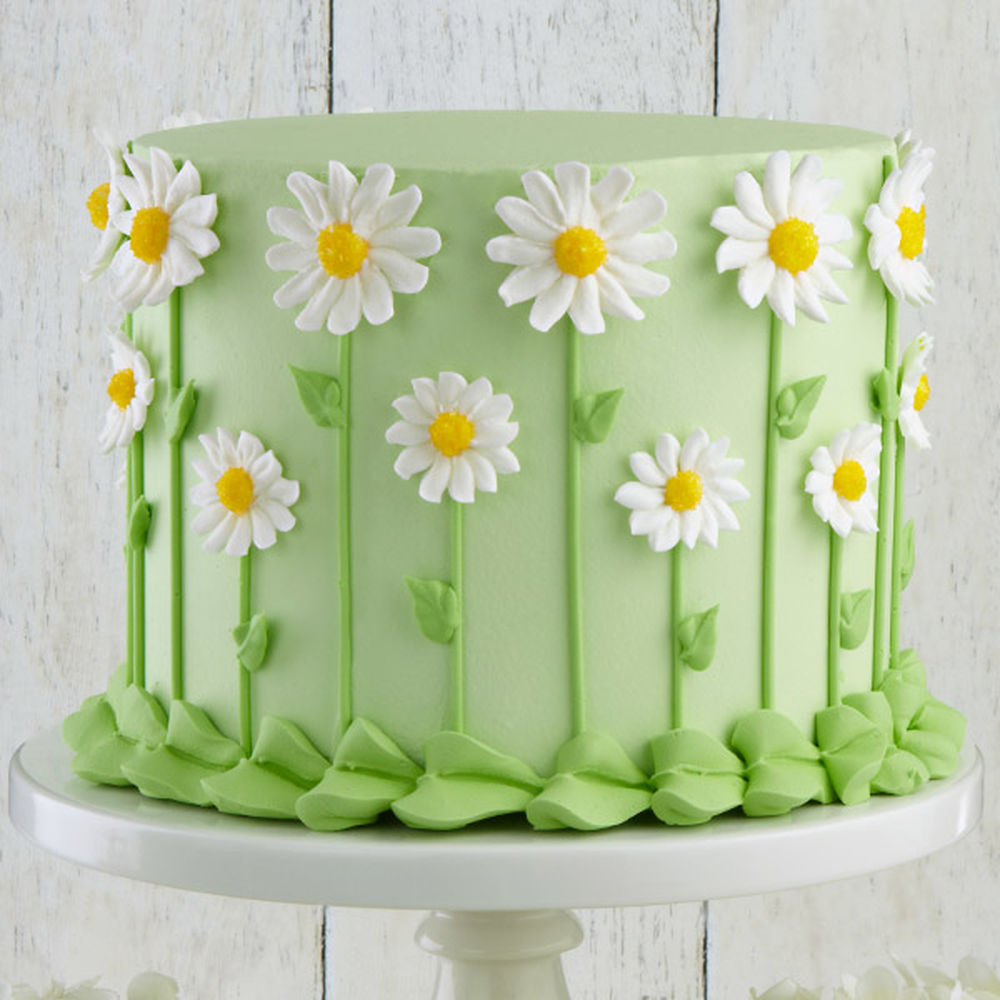 Our favorite fresh-look flower, the daisy forms a fun covering for the sides of this cake. The  centers are dusted with yellow