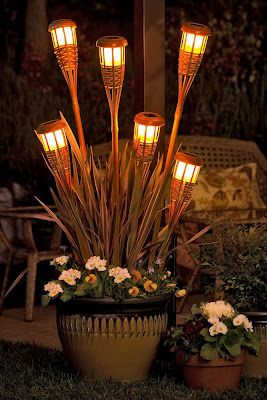 Use Dollar tree solar lights in tiki torch bases….. I love this idea for the deck. – interiors-designed.com