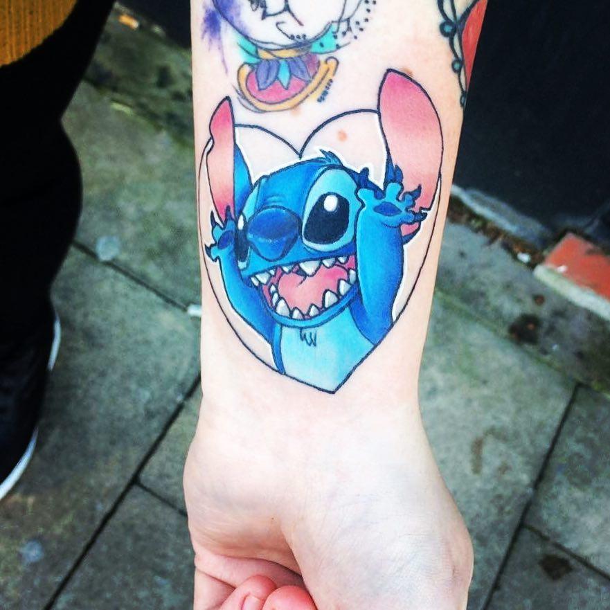 Stitch busting thru heart tattoo