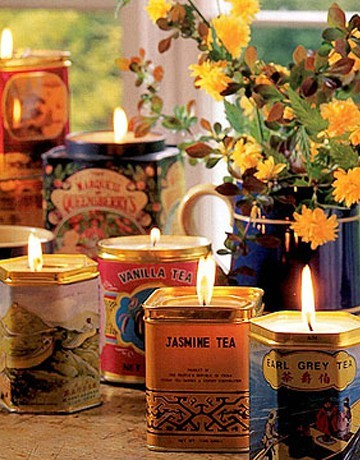 candles in tea tins… I think this is much prettier than the tea tin herb pins floating around – and I can much more easily burn