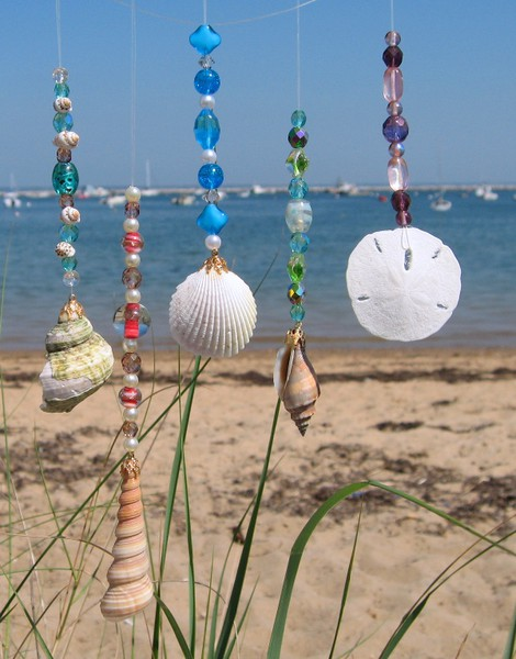 collect as many shells as you can find later get a string but not too heavy and start to tie the string around the shells and sand