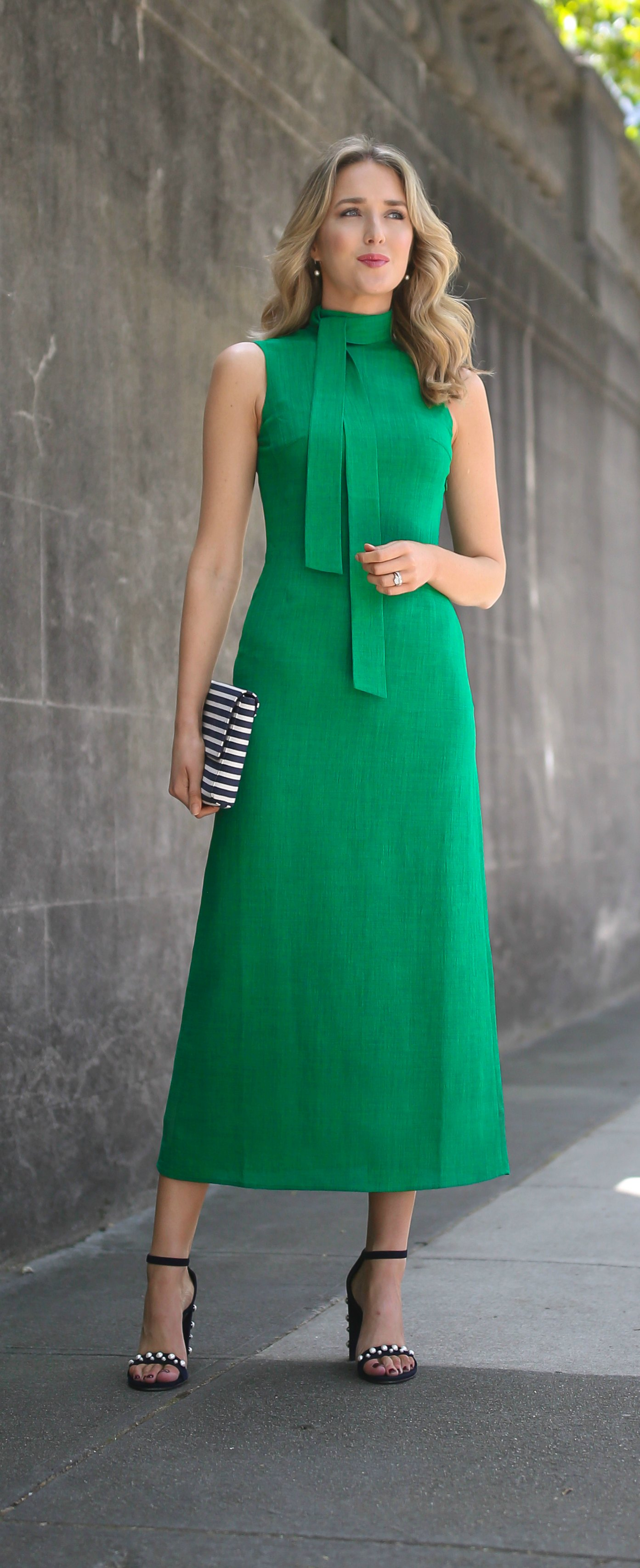 kelly green midi dress with tie neck detail, navy blue suede ankle strap sandals pearl embellished detail and block heel, navy and