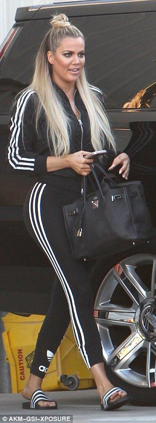 Heading home: The reality star smiled and chatted after another day at the studios for her… KHLOE