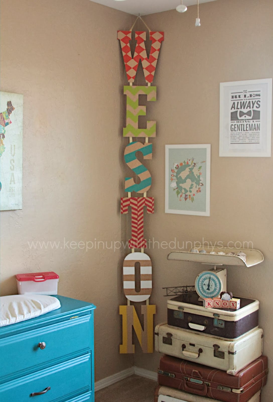 hanging vertical kid's name in the corner – just decorate letters, attach together, and hang.