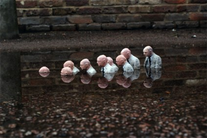 Follow the leader - Isaac Cordal