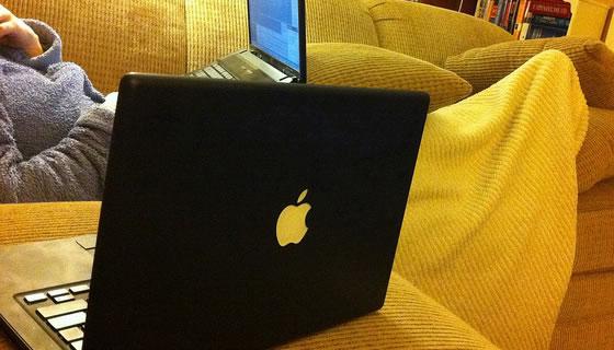 Black MacBook laptop featured image