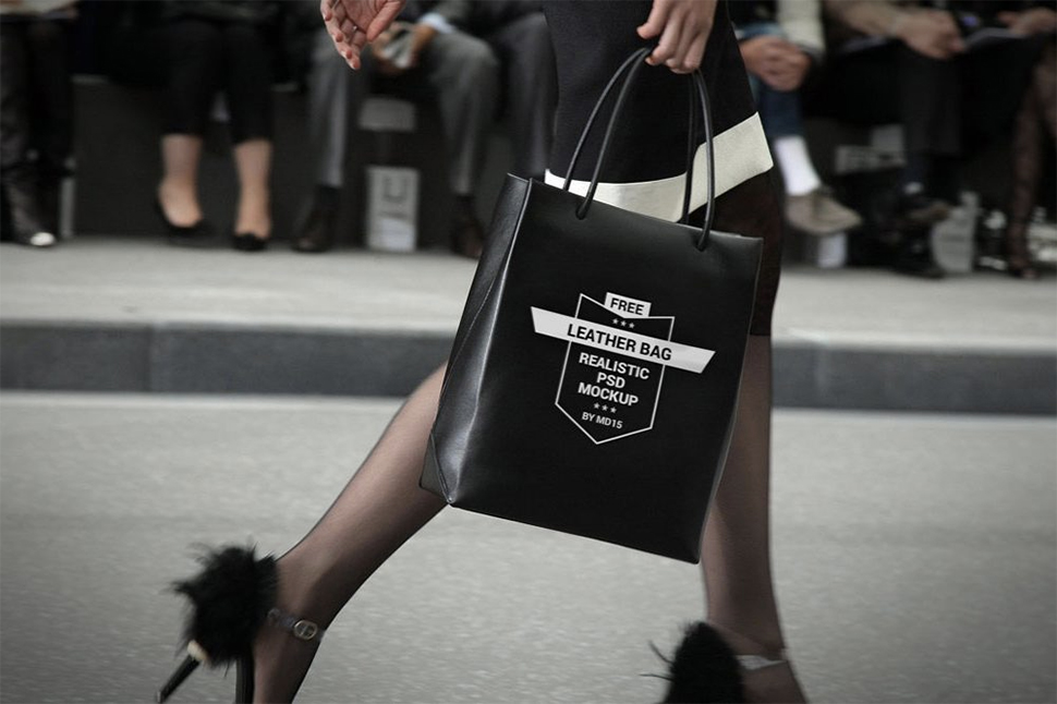 woman-with-black-shopping-bag-mockup