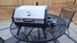 Campro By Martin 14,000-BTU Portable Outdoor Tabletop BBQ grill stainless steel cover