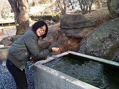 Me pretending to drink off a spring in Cheon An Bear Park, South Korea