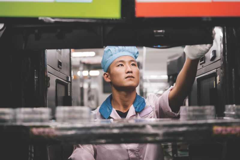 An iPhone assembly worker works with Apple supplier Pegatron in an image distributed by Apple.</div></figcaption> in an audit of supply chain partners, Apple found increased labor violations in 2017 13