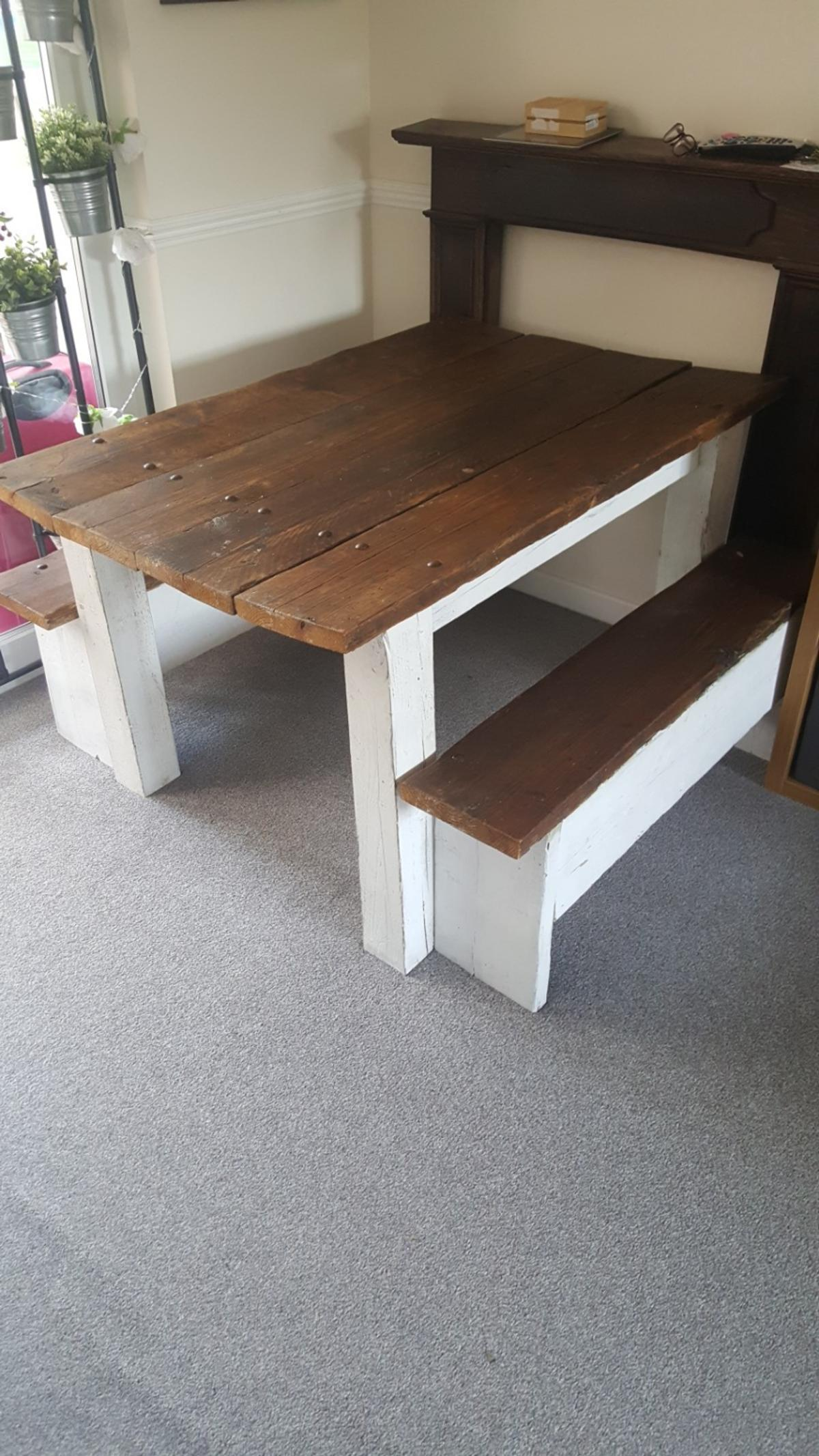 handmade wooden table with benches in