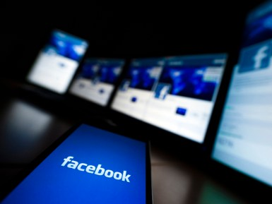 The loading screen of the Facebook application on a mobile phone is seen in this photo illustration taken in Lavigny May 16, 2012. Facebook Inc increased the size of its initial public offering by almost 25 percent, and could raise as much as $16 billion as strong investor demand for a share of the No.1 social network trumps debate about its long-term potential to make money. Facebook, founded eight years ago by Mark Zuckerberg in a Harvard dorm room, said on Wednesday it will add about 84 million shares to its IPO, floating about 421 million shares in an offering expected to be priced on Thursday. REUTERS/Valentin Flauraud (SWITZERLAND - Tags: BUSINESS SCIENCE TECHNOLOGY SOCIETY) - RTR325LT