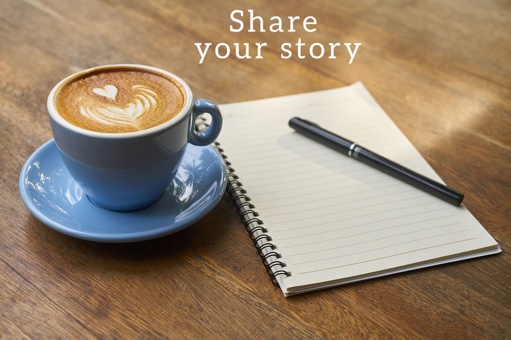 Latte with notebook and pen - share your story