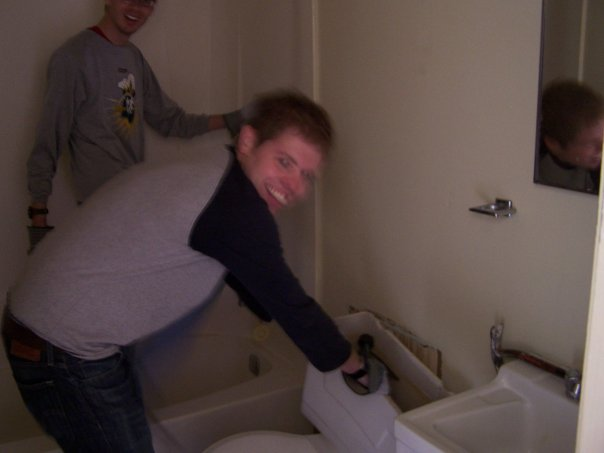 Me ripping a toilet out of the wall of a house we helped tear down in the Everglades