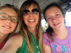 Riding the golf cart with my two big girls