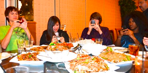 people taking pictures of food