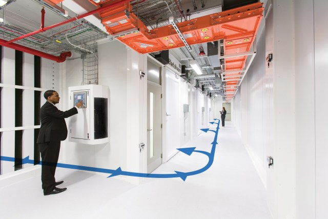 """Figure 4. Supply air from the Bladeroom """"air optimizer"""" brings direct air with DX and evaporative cooling into flooded cold aisles in the data center."""