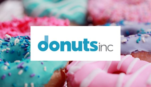 Donuts Inc logo on a picture of donuts