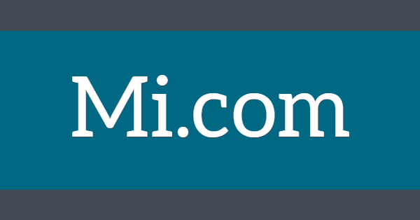 Mi.com in white letters on a green/blue background