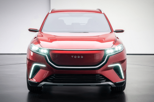 Photo of a Togg SUV, red on showroom floor