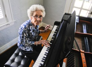 Juanita Hibbett, 92, plays piano in her home on Catalina Avenue in Webster Groves. She has lived in her home since 1958. She sold her home to Webster University two years ago but still lives there rent-free.
