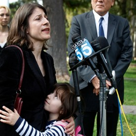 SANTA ANA, CA-NOV. 19, 2013:  Dr. Jorge Mancillas, right, listens to his wife, and daughter, Arianna Mancillas, 4, hugs her mom, Norma Esparza, left, while speaking during a press conference outside the Central Justice Center in Santa Ana Wednesday, Nov. 20, 2013.  (Photo By Allen J. Schaben / Los Angeles Times)