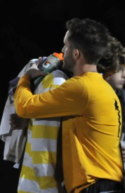 Senior forward Pat McCaffrey is comforted by a teammate after the men's soccer team's SLIAC Championship loss. PHOTO BY MEGAN FAVIGNANO/The Journal