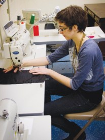 Sophomore costume designer Ruth Tully sews design sketches into costumes for Conservatory productions. PHOTO BY ERIN SHILDMYER/ The Journal