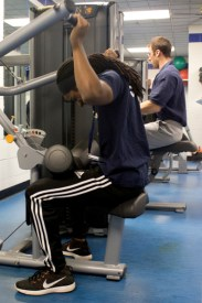 Staff member Hezekiah McCaskill tries out the new Matrix equipment in the Fitness Center. PHOTO BY HANNAH ROLLING