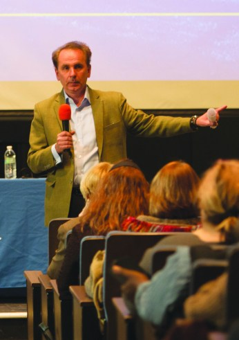 Provost Julian Schuster discusses budget at Faculty Assembly on Feb. 6. PHOTO BY HOLLY SWAN/The Journal