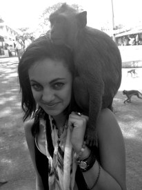 Contributed by Macy Salama A monkey perches on Macy Salama's shoulder. Food sold by a local encourages the monkeys to get close.