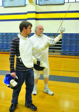 MEGAN WASHAUSEN / The Journal Michael Long works one-on-one with student Kevin Conrad. Conrad took Fencing I with Long and said he returned because the sport is fun and he enjoys the exercise.